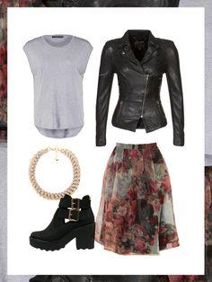 What to wear to work: das perfekte Büro-Outfit. Coole Ankle Boots und schwarze Lederjacke kombiniert mit einem femininen Rock und Statement-Kette.