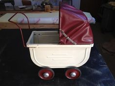 Family treasure - heritage pram with new cover.