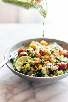 Glowing Grilled Summer Detox Salad! with grilled romaine, lime, tomato, cucumber, avocado, corn, shrimp, and cilantro dressing. | pinchofyum.com