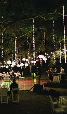event lighting paper lanterns and vertical twinkly lights from bridal bar blog