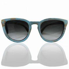"""Marjo Wooden Eyewear """"Bandita Azzurra""""  OUR WINTER SUNGLASSES  Μετώπη και βραχίονες από μασίφ ξύλο ελιάς σε γαλάζια απόχρωση και γκρί ντεγκραντέ φακούς."""