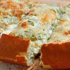 Recipe for Artichoke Bread - The warm artichoke dip with the melted cheesy topping was so good and the fact the it was in the perfectly cooked bread made it even better!
