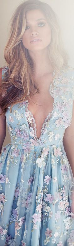 I don't like how much breast the dress shows but it is still really pretty: