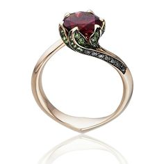 By multi-award-winning British jewellery designer Tomasz Donocik, From the Garden of Good & Evil Collection, this ring is also known as the Beauty and the Beast ring after Disney's famous romance Set with a 0.20 carat rubellite, with leaves of tsavorites and black diamonds in place of prongs to hold the rich, red gemstone in place