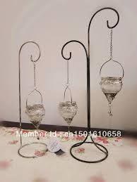 Resultado de imagen para pies de hierro blanco altos para colgar velas bodas