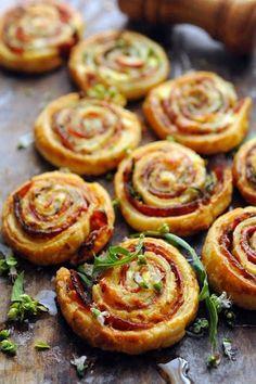 Christmas-colored pinwheels: rolled ricotta, chorizo, arugula and basil.