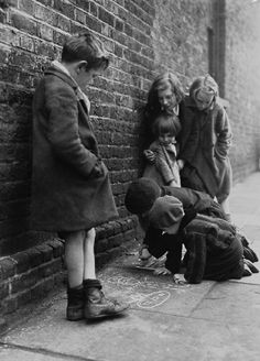 D. H. Calcraft - Children drawing on the pavement, 1941. S)