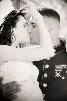 Bride and Marine Groom after the wedding. Photo by Dotson Studios.
