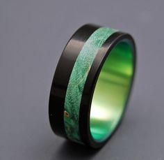 wedding rings - titanium, wood and anodized green