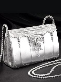 Ginza Tanaka  The nearly $2 million bag features a diamond shoulder strap that doubles as a necklace,