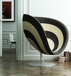 Deze stoel spreekt me erg aan! De vorm en de grootte, je kunt er helemaal in verdwijnen. Alsof door een spiraal wordt meegenomen naar een andere wereld. Rosa - Poltrona chair
