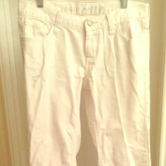 """Old Navy white jeans Old navy white jeans with distressed spots on legs and back pocket - very cute! Like new / excellent condition with no stains or marks! One photo shows example of distressed spot. Size """"2 Regular"""" Old Navy Jeans"""