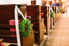 the chapel aisle is dressed and ready for the bride with fresh green boxwood wreaths tied to the pews with cream satin ribbon. Floral Wedding, Rustic Wedding, Our Wedding, Wedding Flowers, Dream Wedding, Wedding Things, Wedding Stuff, Pew Decorations, Wedding Decorations
