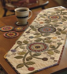 Use Kim Diehl's invisible machine-appliqué technique to stitch this penny-packed Cottage Garden table runner - gorgeous!