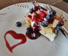 blueberry french toast souffle white bread cream cheese cup of fresh blueberries 6 eggs 1/4 c maple syrup cup of milk cinnamon vanilla grease 8x8 pan sprinkle bread cubes, dollops of cream cheese and berries, pour liquid over and rest overnight. bake at 350 until golden, 30-40'