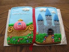 Princess Book Cake - This is two 9x13 cakes placed side by side.  Then iced in buttercream with fondant accents.  Crushed graham cracker roads.  I also used gold luster dust for the gold on the carriage and to make the pages gold around the sides.