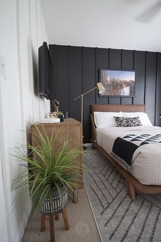 Black and white mid-century modern teen boy bedroom makeover with lots of DIY projects for a stunning, yet inexpensive, result.