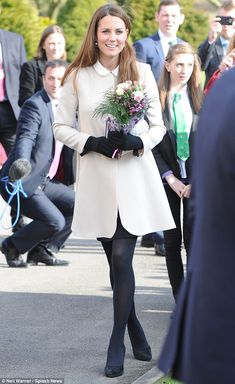 Kate, 31, who is around five and half months pregnant, had a healthy flush to her cheeks and a broad smile on her face as she collected armfuls of posies and two fluffy teddy bears from well-wishers in Buckinghamshire