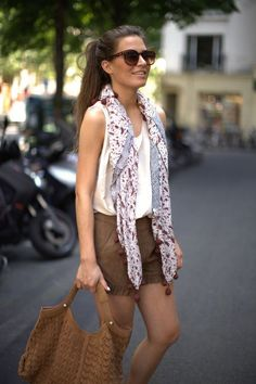 A loose scarf paired can we paired with shorts and tank for a pulled together summer outfit.