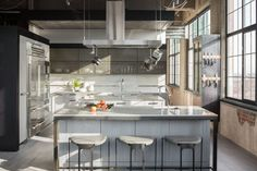 Modern kitchen with oak and metal cabinets