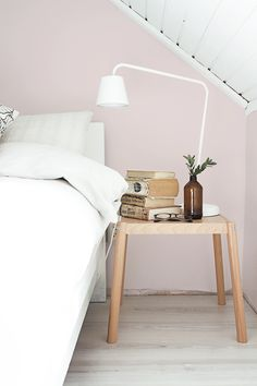 pastel pink wall in a bedroom.