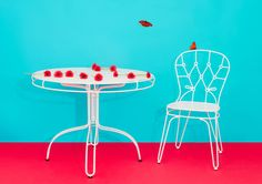 Outline collection: chair and round table, design Alessandra Baldereschi