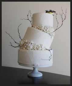 I think this is a terrific wedding cake! Much like a marriage ... fabulous, even when it's a little lop-sided and imperfect.