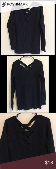 Warm black criss cross back sweater Cross cross back design on back of this gorgeous, soft, very warm sweater. Some pilling from wear (pictured) but overall in good condition. Care instructions provided Poof Excellence Sweaters Crew & Scoop Necks