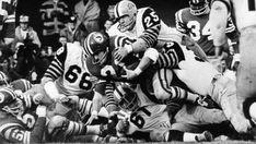 Saskatchewan ball carrier, Al Ford (21), is smothered by four belligerent Hamilton defenders in the 1967 Grey Cup.