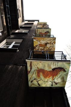 cave paintings on the bottom of balconies