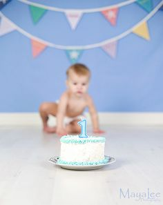 Cake smash. I love the pennants hanging in the background!