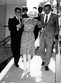 Marilyn Monroe visiting an orphanage during her trip to Mexico, March 1st 1962. Looks like she may have had too much champagne , drinking at the press conference. She is so thin at 118 lbs.