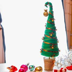 Mini Christmas wool tree with golden ornaments New Year