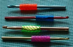 Add pencil grips to crochet hooks for comfort and design. What a great idea!