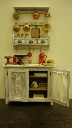 miniature cabinet with doors., via Etsy.
