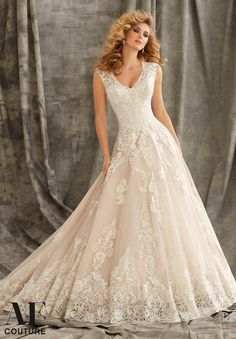"""Bridal Gowns By AF Couture featuring Embroidered Appliques on Tulle Ball Gown with Wide Hemline Border Available in Three Lengths: 55"""", 58"""", 61"""". Colors Available: White, Ivory, Ivory/Caramel"""