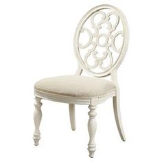 """Side chair with an ornate open back and turned legs.   Product: ChairConstruction Material: Elm and birch woodColor: WhiteDimensions: 40"""" H x 22"""" W x 25"""" D"""