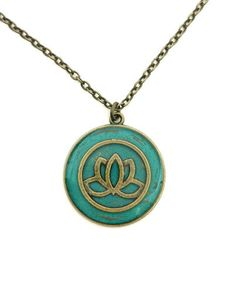This necklace features a brass lotus flower that sits in a round pendant with a gorgeous teal background that makes the lotus flower stand out perfectly.