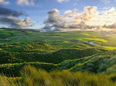Inishowen, Ireland  Photograph by Dave Johnston  Morning sun touches the hills and sand dunes of Inishowen, Ireland.