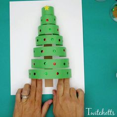 How to make a fun paper Christmas tree craft - Twitchetts A paper Christmas tree that is perfect for preschoolers and kindergarteners. This tree is a great construction paper craft that you can create with kids. Christmas Arts And Crafts, Cool Christmas Trees, Simple Christmas, Christmas Projects, Kids Christmas, Holiday Crafts, Christmas Decorations, Christmas Pine Cones, Country Christmas