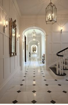 black and white marble floor with the white walls and trim work- perfectly timeless. - black and white marble floor with the white walls and trim work- perfectly timeless. Black And White Hallway, Black And White Marble, White Walls, Black And White Flooring, White Rooms, White Trim, Large White, Foyer Flooring, Kitchen Flooring