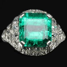 *Beautiful Art Deco platinum ring set with a 6.28 carat Colombian emerald and old size 1.5 carat ring dated circa 1920 in perfect condition and comes with certificate diamonds. Around 1920