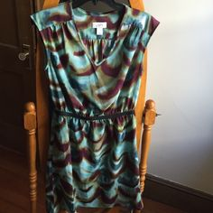 New LOFT dress multi color Purchased at Ann Taylor LOFT, new condition. Mix of colors - dark purple, Aqua, brown. Black elastic band around waist, V neck line LOFT Dresses