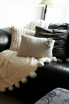 Sweater Pillows  Source  http://www.hometalk.com/911551/using-old-sweaters-to-make-super-cute-pillow-covers