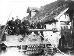 "Pz.VI Tiger ""443"" and panzermänner from 9. SS-PzRgt 3 ""Totenkopf"" in Mikojanowka. In the middle is tank commander SS-Oscha. Baumann Kharkov 1943"