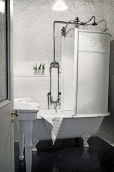 This bathroom, located within a renovated historic property, plays up a distressed, textured wall to it's advantage.