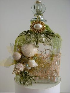 Altered bottle with sea shells by Donna Perry