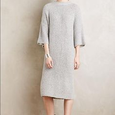 Comfiest Sweater Dress in the World This sweater dress is one of the comfiest pieces of clothing you will ever encounter (in my opinion).  The soft grey color will look great with a pastel shoe or classic black boots.  Would live in this if I could.. Size small but could easily fit Medium.  Please note, sleeves realistically come down to right above the elbows, not past the elbows like in the cover pic with model. Dresses Midi