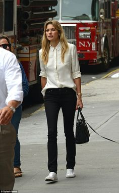 Peekaboo! Jessica Hart braless under her silk shirt while walking her dog in New York City...