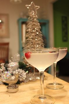 "Oh, are you going to love, love, love this cocktail! I mean, just look at it. Doesn't it make you think of the holidays? Seriously, I can hear Bing Crosby crooning ""White Christmas"" in my head right now. Love it! White Cranberry Martini, A Winter Wonderland Cocktail."